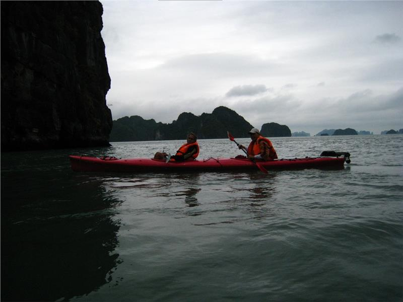 Exploring caves in Halong Bay with Kayaks