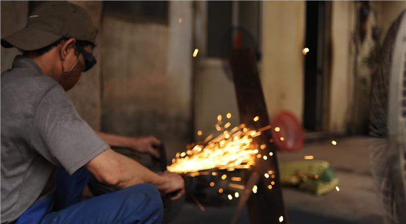 A Blacksmith in Da Sy craft village - Hanoi