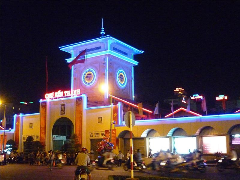 Southern gate of Ben Thanh market in colourful lights