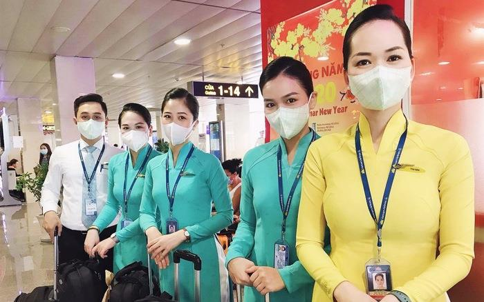Attendant of Vietnam Airlines wear masks at airports