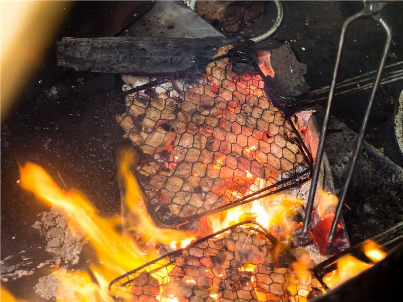 Grilling the pork for Bun Cha