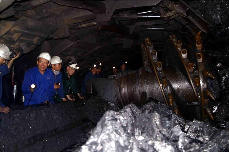 Miners are working in the mine ore